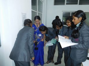 Students performing Practicals in Physics Lab