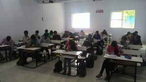 Students writing weekly exam